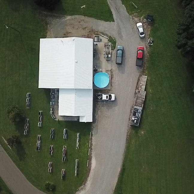 Aerial view of a roof that has a brand new coating on it.